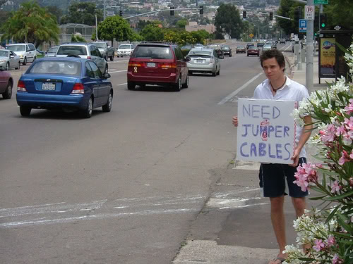 Douchebag Millennial with sign for jumper cables