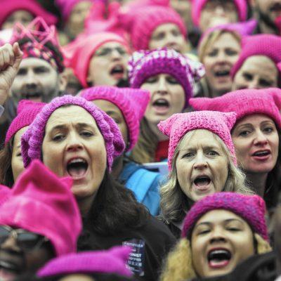 Women bouncers in pussy hats