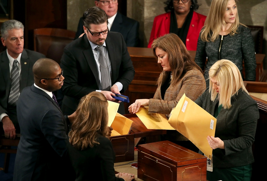 The actual Electoral College in 2020 opening old wooden boxes to open old style manilla envelopes.  When can we get rid of this ancient, fake ceremony?