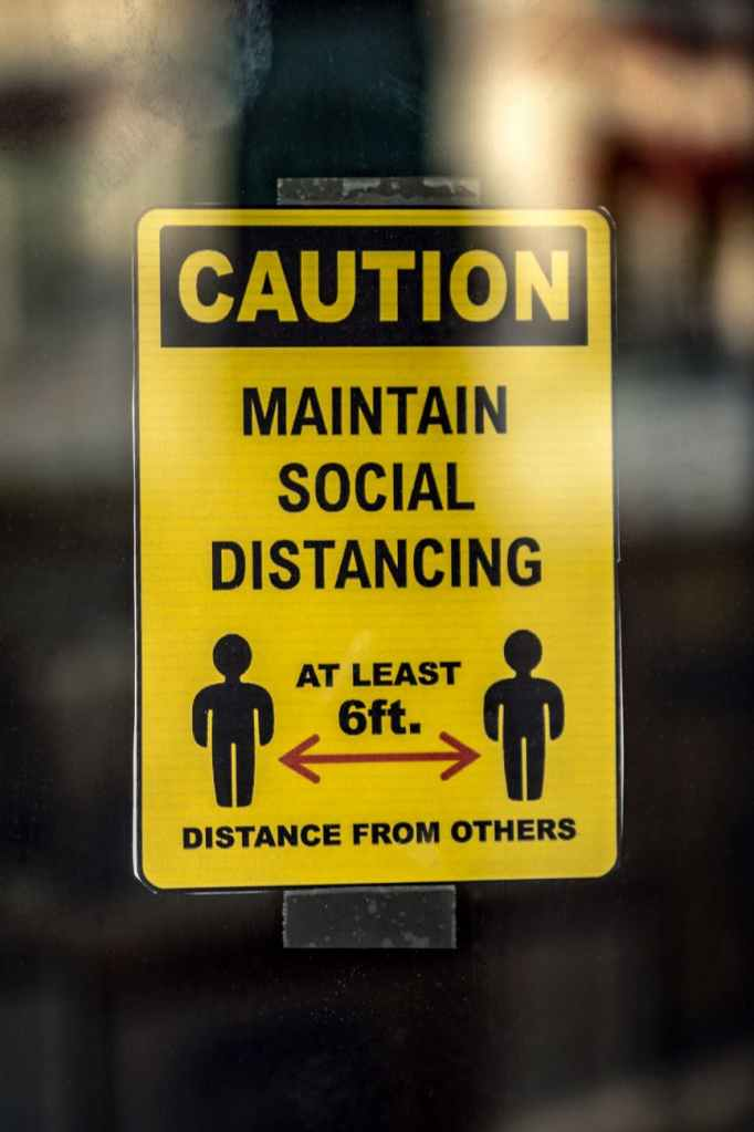 Caution sign - Maintain Social Distancing